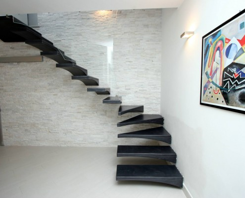 Gull wing resin staircase with glass banister