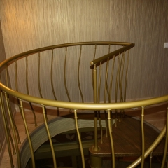 Spiral-staircase-in-gold-finishing-Moscow