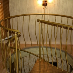Spiral-staircase-in-gold-finishing